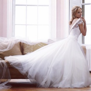 Sassi Holford in wedding dress shop Sarah Elizabeth Bridal Cheltenham